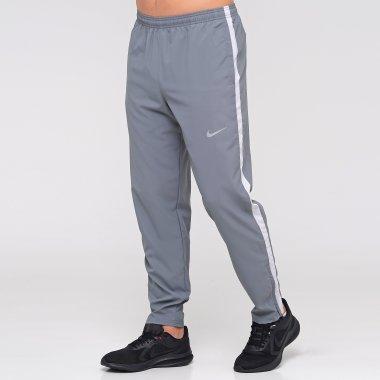 Спортивні штани nike M Nk Run Stripe Woven Pant - 127685, фото 1 - інтернет-магазин MEGASPORT