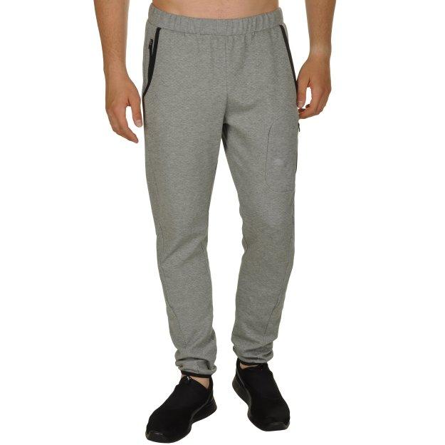 Спортивные штаны Puma Evostripe Lite Pants - MEGASPORT